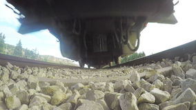 POV shot from under a Train travelling on the tracks. Train travelling on the tracks at high speed stock video footage