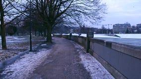 POV steadicam walk along Vistula river embankment in winter. Krakow, Poland. 4k video