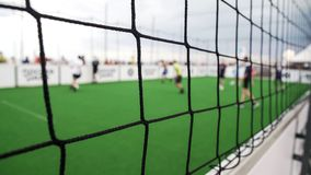 POV of supporter watching amateur teams play soccer game, active lifestyle. Stock footage stock photo