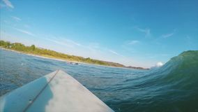 POV of the surfer stock footage