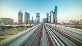 POV timelapse journey on the driverless elevated Rail Metro System, running alongside the Sheikh Zayed Road. 4K Timelapse in Dubai, United Arab Emirates stock video footage