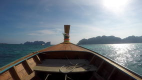 POV on a traditional long-tail wooden Thai boat on the ocean - Limestone islands stock video
