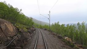POV train travelling in Abisko National Park, Lapland, Sweden. POV travelling along a Iron line Kiruna - Narvik, in Abisko National Park, Lapland, Sweden stock video