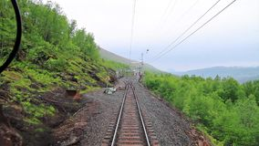 POV train travelling in Abisko National Park, Lapland, Sweden. POV travelling along a Iron line Kiruna - Narvik, in Abisko National Park, Lapland, Sweden stock video footage