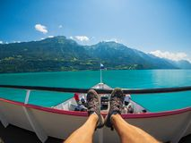 POV travelling by boat at Brienz lake at summer time in Switzerland. stock photo
