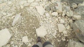 POV trekking in Norway. POV handheld trekking over rocks in Norway stock video footage