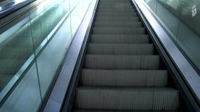 POV video riding an escalator up from an underground railway station into city daylight. POV 4K video clip riding an escalator up from an underground railway stock footage