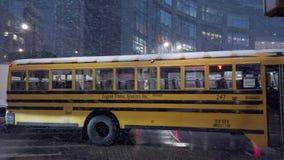 POV view of heavy snow storm hits peak hour traffic on 8th Avenue Columbus circle in midtown Manhattan