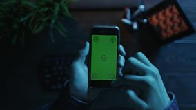 POV view of man using his smartphone with green screen stock footage
