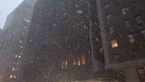 POV view of snow falling on 7th avenue in midtown Manhattan