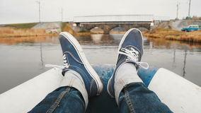 POV view of a tourist moving feet on the boat ride