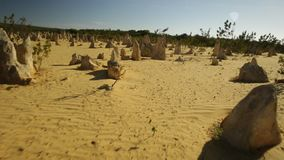 The Pinnacles at noon. Pov walking in the big limestone formations at noon at The Pinnacles Desert, Nambung National Park. The Pinnacles are the major tourist stock video footage