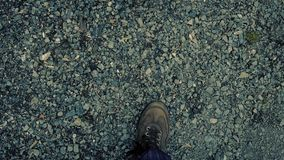 POV Walking On Gravel Path In Evening. Looking down at feet walking on a rocky trail through the forest stock footage