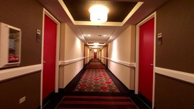 POV of walking in long corridor. At a hotel stock video footage