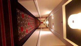POV of walking in long corridor. At a hotel, barrel roll stock video