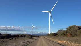Pov walking toward large wind turbine on a sunny day. stock video