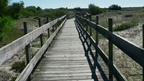 POV Walking on Wooden Walkway in the Sand Dunes stock video footage