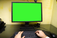 POV of worker sitting at his desk working at Royalty Free Stock Photography