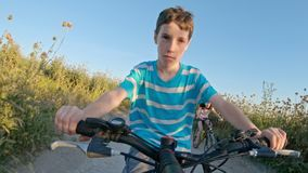 POV of a young boy enjoying a bicycle ride on the rural countryside stock video