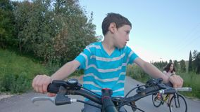 POV of a young boy enjoying a bicycle ride on the rural countryside stock footage