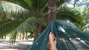 POV young caucasian woman swinging in hammock stock footage