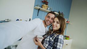 POV of Young happy couple taking selfie photos while having breakfast time in the kitchen at home. Early morning stock footage
