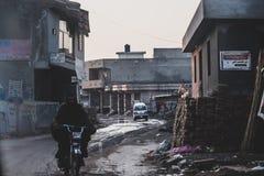 Povertà con un tocco di olio di motore fotografia stock libera da diritti