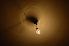 , poverty. Nude light bulb at ceiling Stock Photography