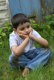 Poverty. Portrait of a young impoverished or runaway French-American boy stock photography