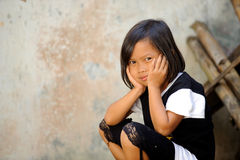 Poverty Child. Outdoor portrait of Indonesian child living in poverty royalty free stock images