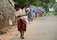 POVERTY CHILD IN INDIA. Child in Tamil nadu, India, an image of poverty in modern age. Image taken outside the house. Two young girl, hand in Hand.Photo taken on royalty free stock photos