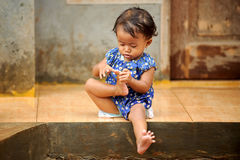 Poverty Child Playing Royalty Free Stock Images