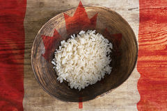 Poverty concept, bowl of rice with Canada flag royalty free stock image