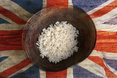 Poverty concept, bowl of rice with UK flag royalty free stock photo