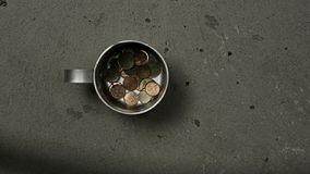 Poverty concept with tin mug stock footage