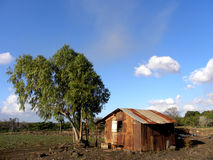 Poverty house in a beautiful landscape Royalty Free Stock Photos