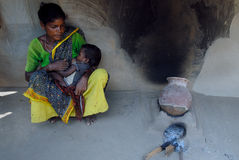 Poverty In India. October 28,2011 Dukru,Purulia,West Bengal,India,Asia-A poor tribal woman breastfeeding in her house at the remote village of Purulia West Stock Image