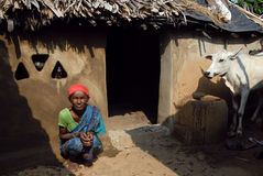 Poverty in India. October 28,2011 Kashipur,Purulia,West Bengal,India,Asia-A poor tribal woman sitting in-front of her hut at the remote village of Purulia West Stock Images