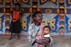 Poverty in India. November 12,2011 Rampurhut,Birbhum,West Bengal,India,Asia-A poor man holding his grand son at the remote village of West Bengal Royalty Free Stock Photos