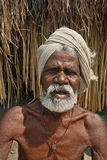 Poverty in India. An old sick man in the rural West Bengal of India Royalty Free Stock Photography
