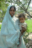 Poverty in India. A poor woman holding her malnourished child in the rural West Bengal Stock Photo