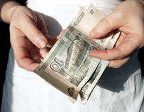 Poverty line. Ten rubles in hands of old women Stock Photography