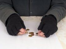 Poverty - man counting money, change - Euros Stock Photos