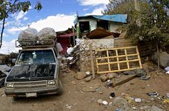Poverty in Mexico slum. Recycled cans are stored on roof of a car in a slum area of Mexico stock image