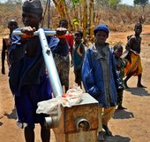 Poverty, Niassa, Mozambique. Another photo depicting poverty in Northern Mozambique's Niassa Province. Youngsters gather at a borehole to collect water. A lot of Royalty Free Stock Photos