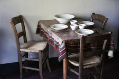 Poverty. Old furniture and tablecloth as signs of poverty royalty free stock photography