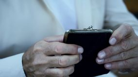 Poverty, pensioner holding empty wallet, default and bankruptcy, economic crisis. Stock photo stock image