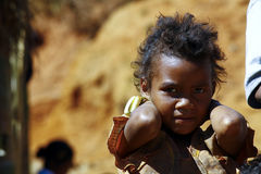 Poverty, portrait of a poor little African girl Stock Image