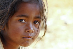 Poverty, portrait of a poor little African girl. Lost in deep thoughts Stock Image