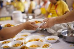 The Society of Sharing Food to Homeless and the Poorest: The Concept of Feeding. Poverty in society Poor people have been donating food from the philanthropist stock photos